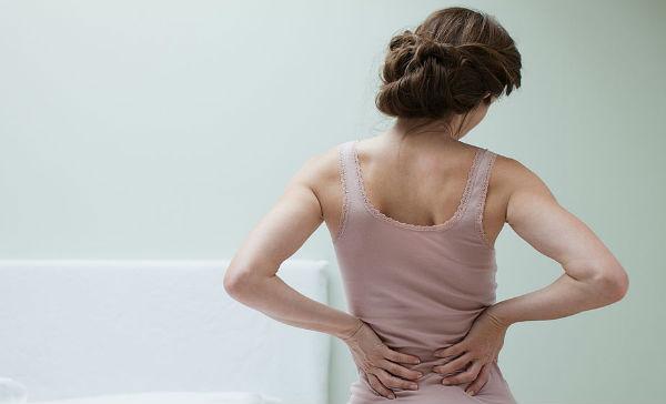 Cargar espalda dolor pesado de